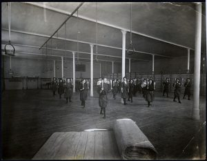 Babcock established Physical Education as an important component to education. She is standing near the pillar at the center.