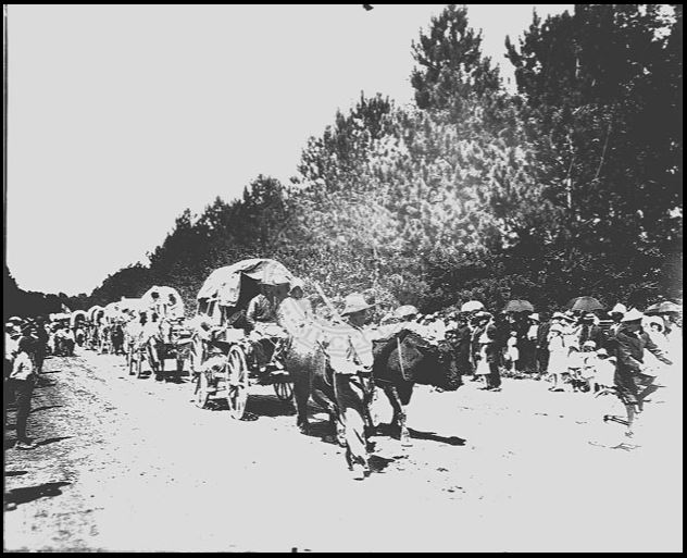 Wagon train commemorating the entrance of the Mormon pioneers into the Salt Lake Valley, circa 1890s | P0790 Shipler Studio Photograph Collection