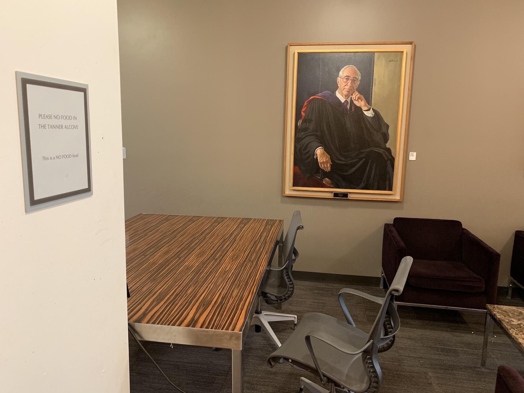 A portrait of Mr. Tanner near a desk in the alcove.