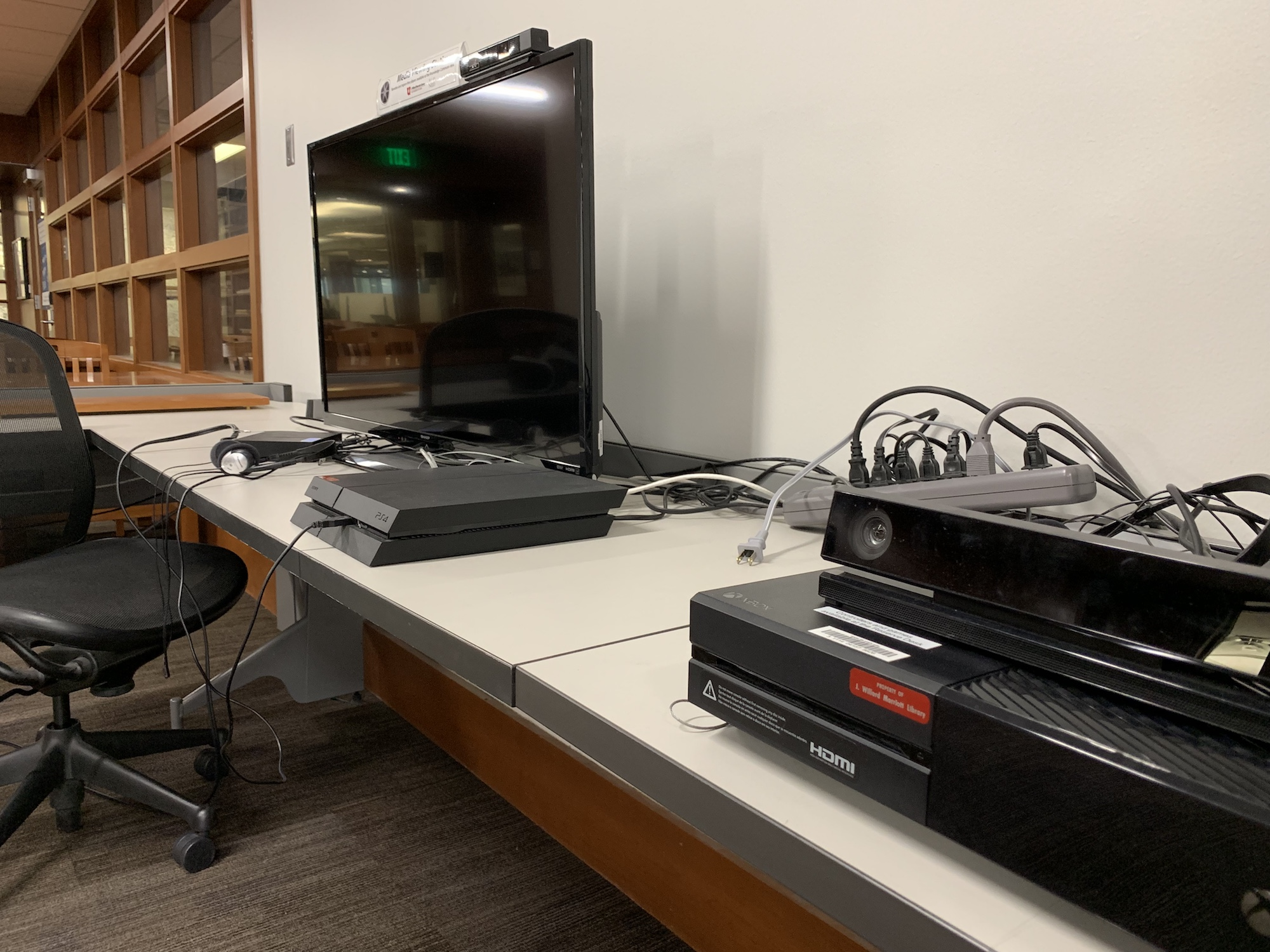 The Xbox One and PS4 area in the fine arts library.