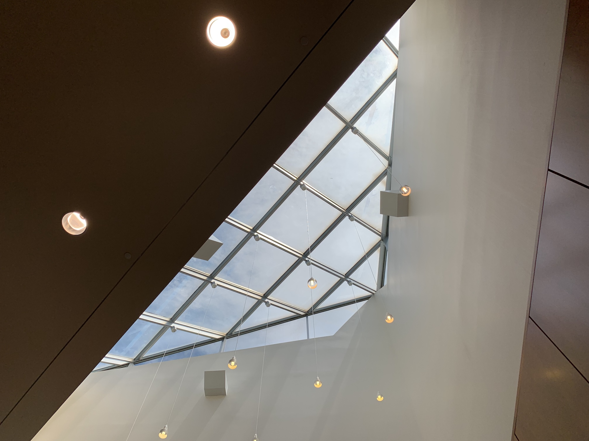 A skylight window above a study area letting light on the desks below.