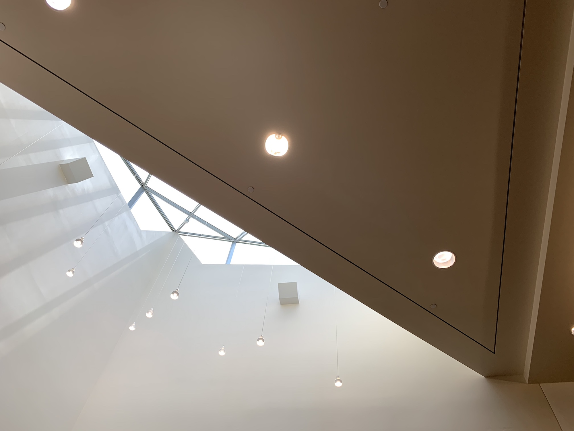 Another view of the skylight above some work desks.