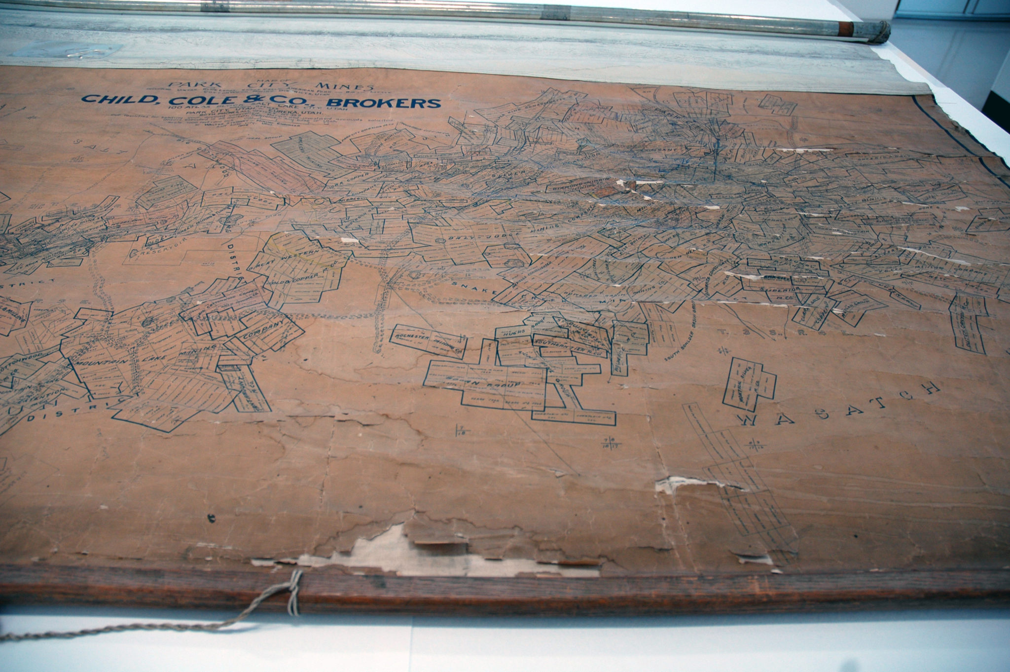 Large areas of loss, with lifting paper fragments scattered throughout the map.