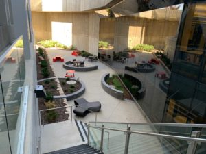 The open space of Katherine's Courtyard with seating for visitors of the Marriott Library.