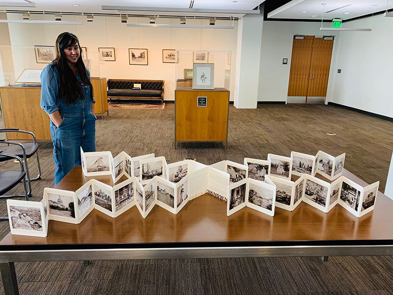 student with artist's book in SPC Reading Room