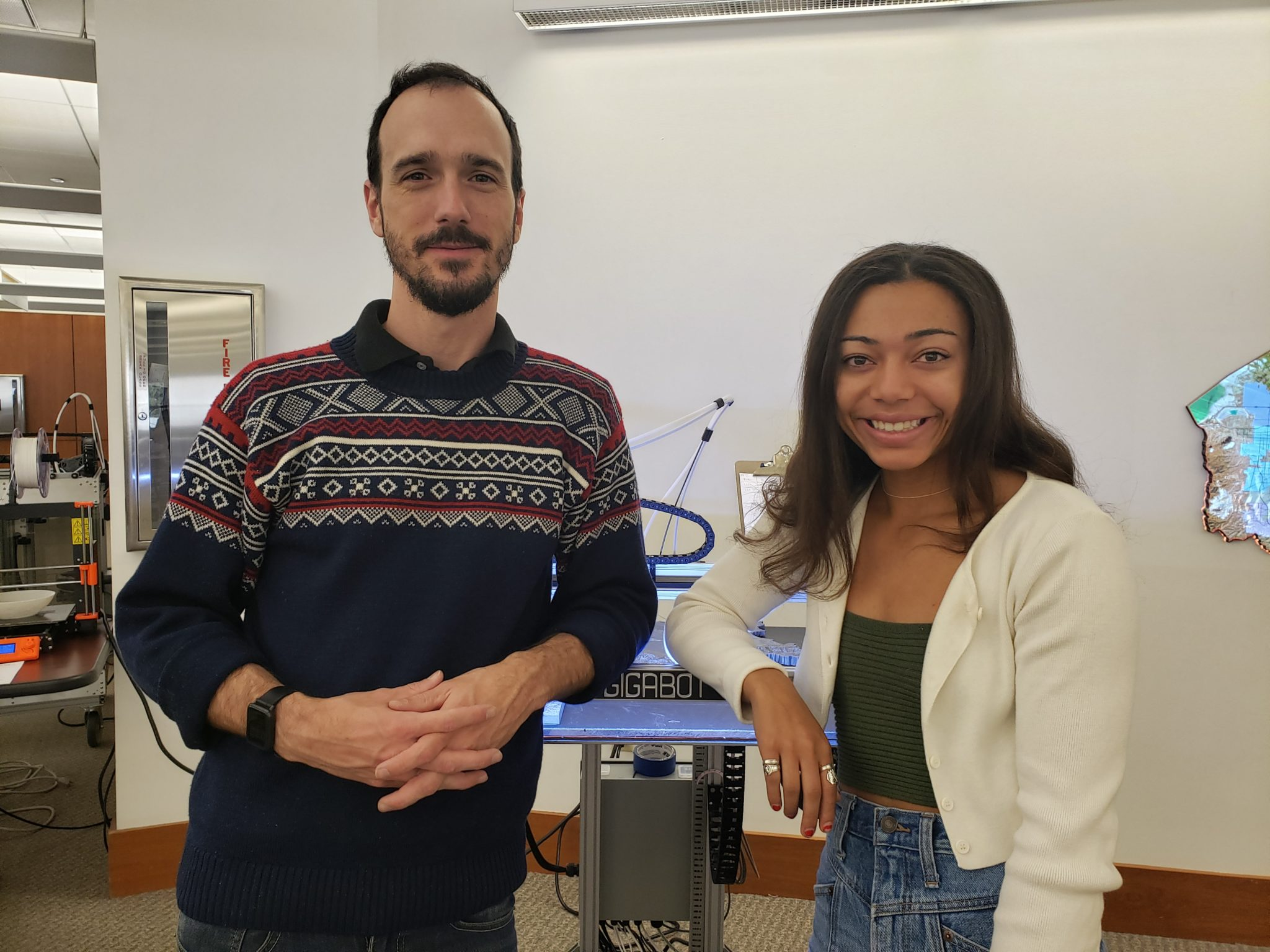 TJ Ferrill, Assistant Head of Creative Spaces, works with biology major and honors student Ayana Amaechi to create an item needed for research.