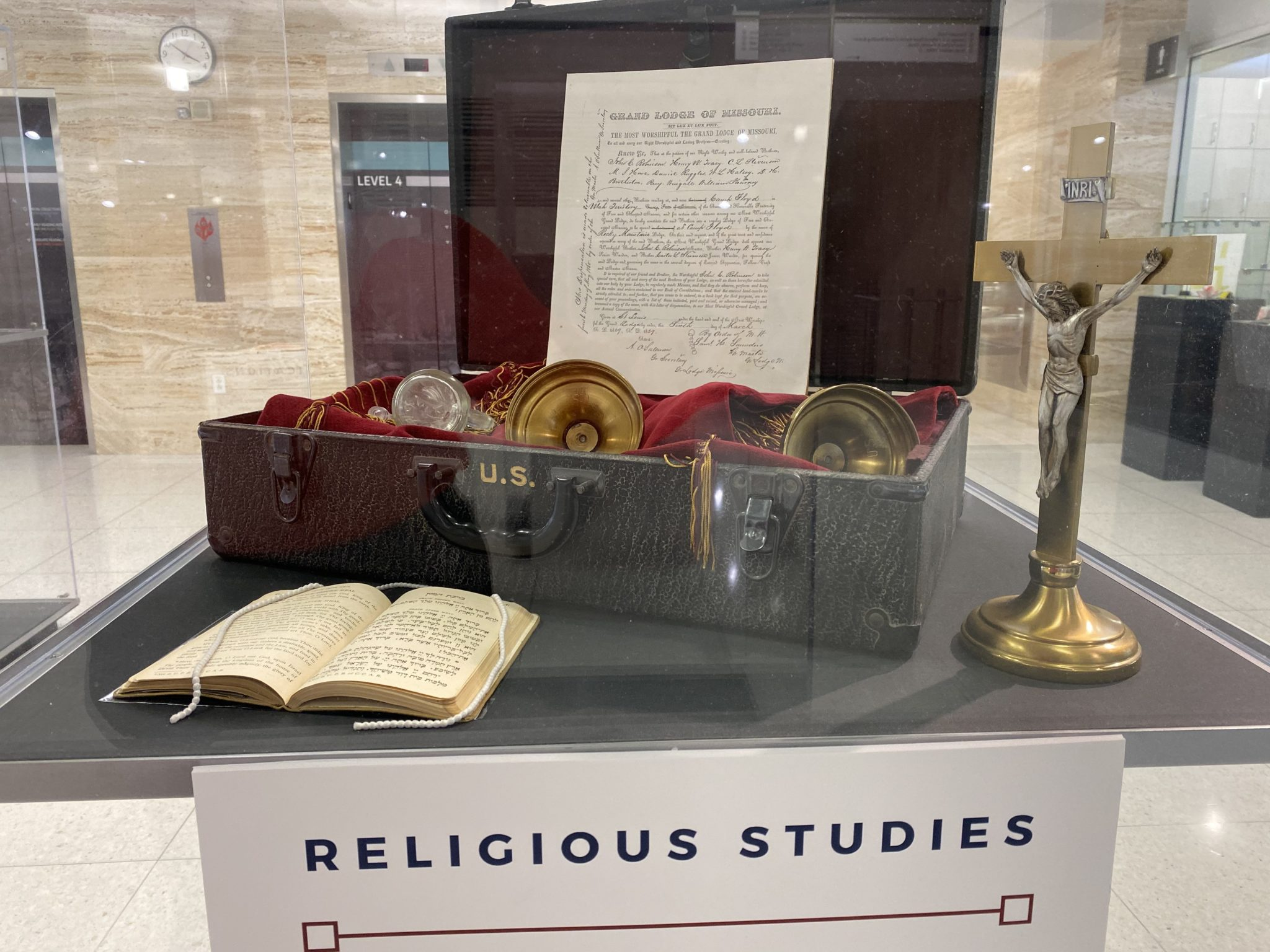 religious artifacts inside of a glass case