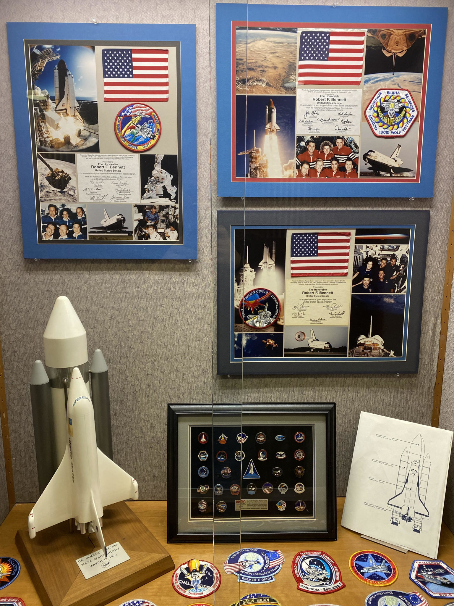 display of collages, model space ships, and patches