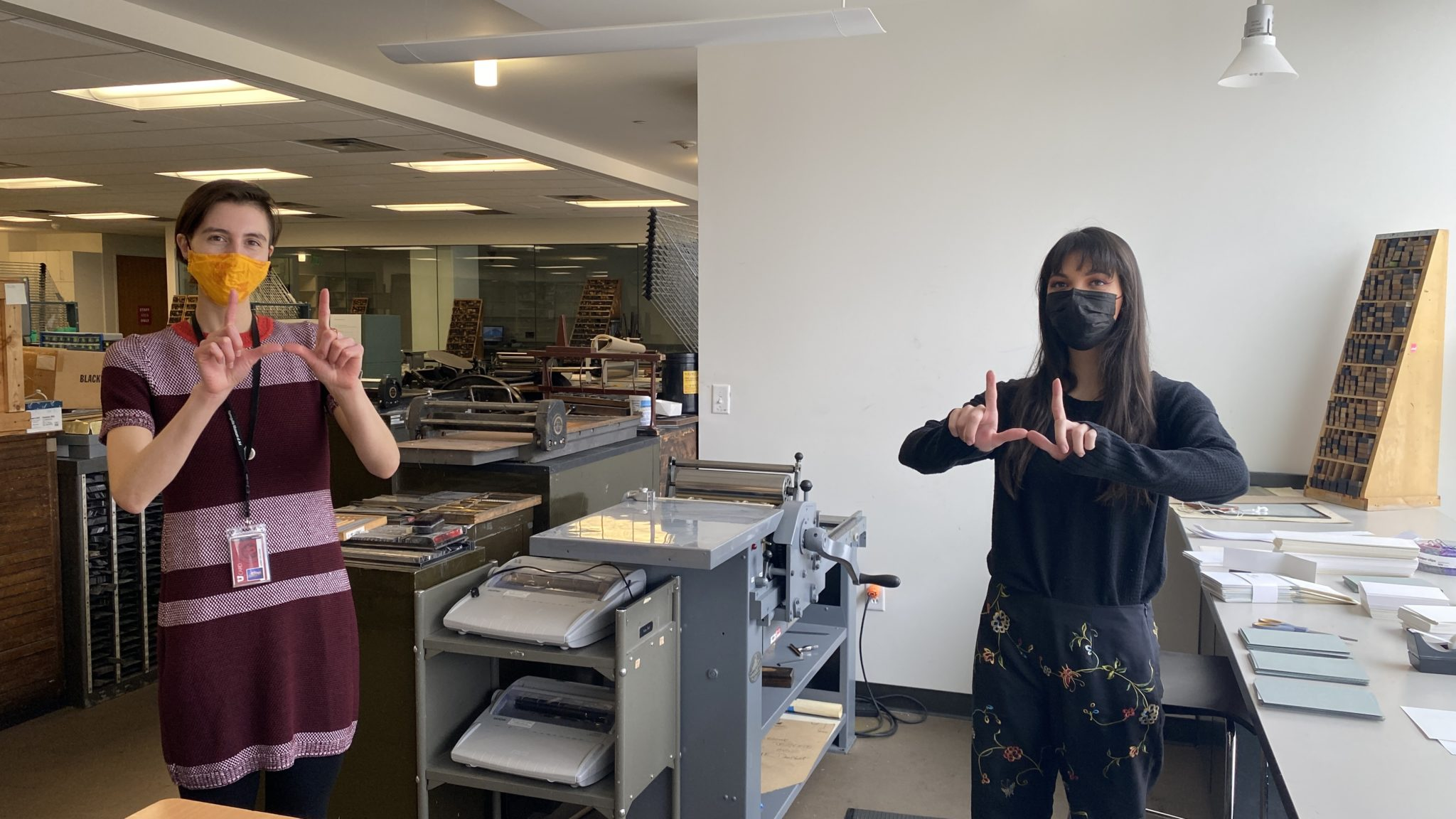 Jazmin Gallegos (left), K-12 & Community Education Specialist, and Victoria Dennis (right), senior in the College of Fine Arts and Book Arts Program intern, in the Book Arts Studio.